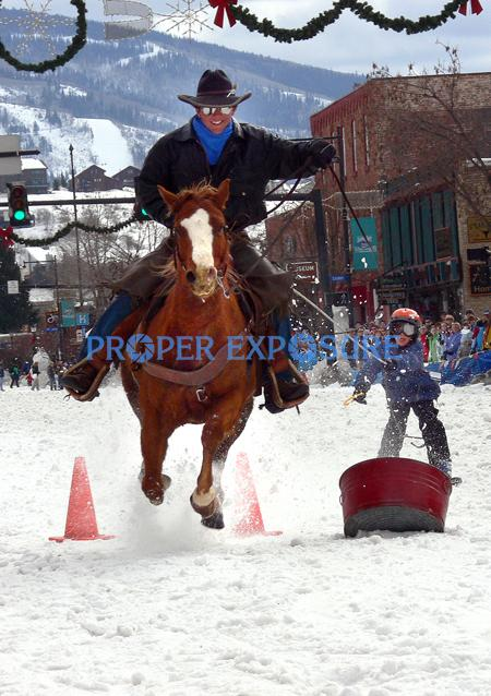 Horse, horse rider, and skier, Winter Carnival, street event, cowboy, downtown, Steamboat Springs, Colorado
