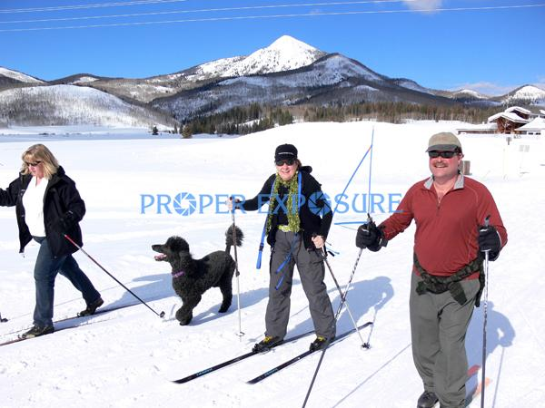Nordic, Classic, skiers, couple, lifestyle, tour, ski, skis, track, man, two woman, Hahns, Peak, Steamboat Lake, sunny, blue sky, dog, blck poodle