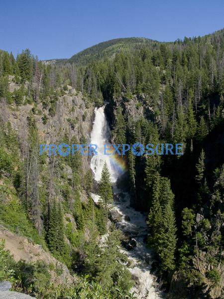 Steamboat Springs; Colorado; Fish; Creek; Falls; Routt County; Ken Proper; water; rainbow; rocks; evergreens; pine; tree; blue sky; Fish Creek Falls