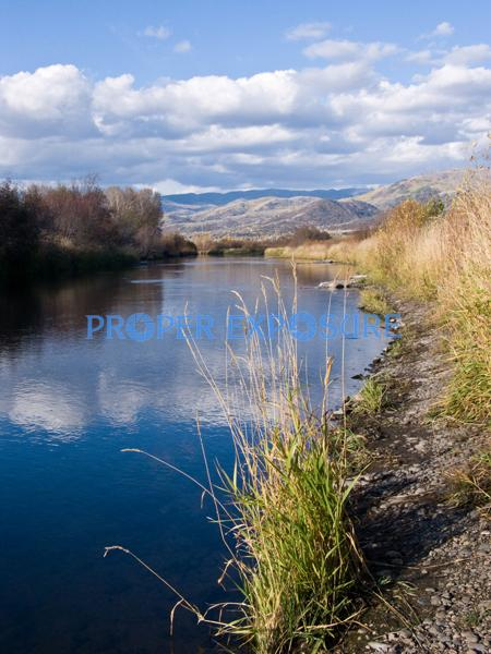 Yampa; River; Routt County; water; fall; foliage; fishing; clouds; blue; sky; Steamboat Springs; CO; Colorado; reflection, vertical