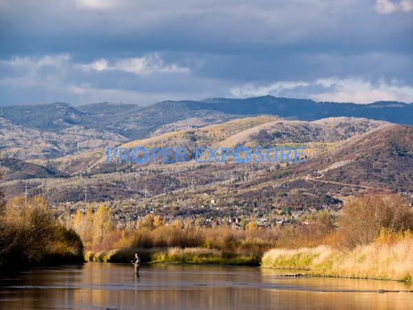 Yampa; River; Routt County; water; fall; foliage; fishing; clouds; blue; sky; Steamboat Springs; CO; Colorado; reflection, horizontal, fisherman